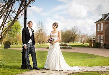 Wedding portrait outside venue in Kent.