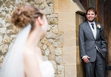 bride looking lovingly at groom photo