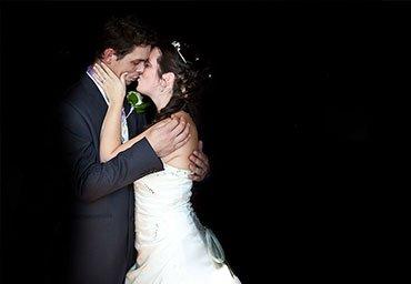 Married couple kissing portrait