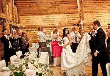 Bride and groom entering the reception venue photo